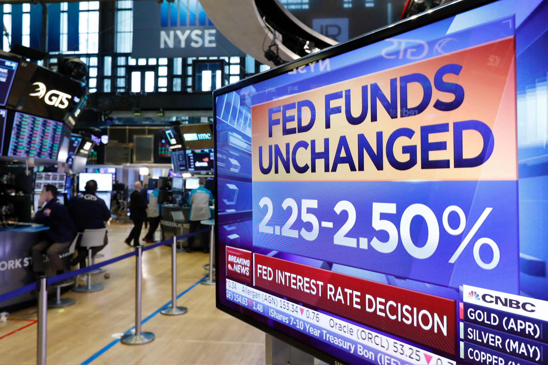 US stock indexes are mostly lower after Fed policy decision