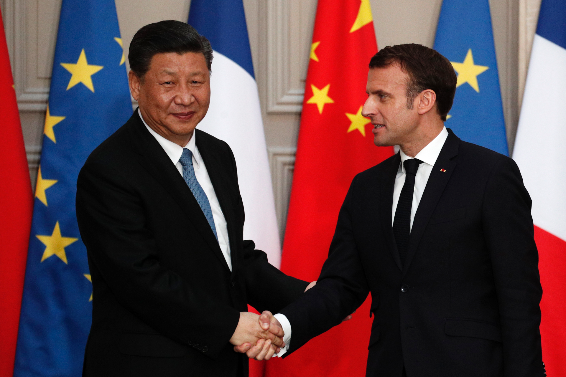The Latest: China, France push climate-friendly finance