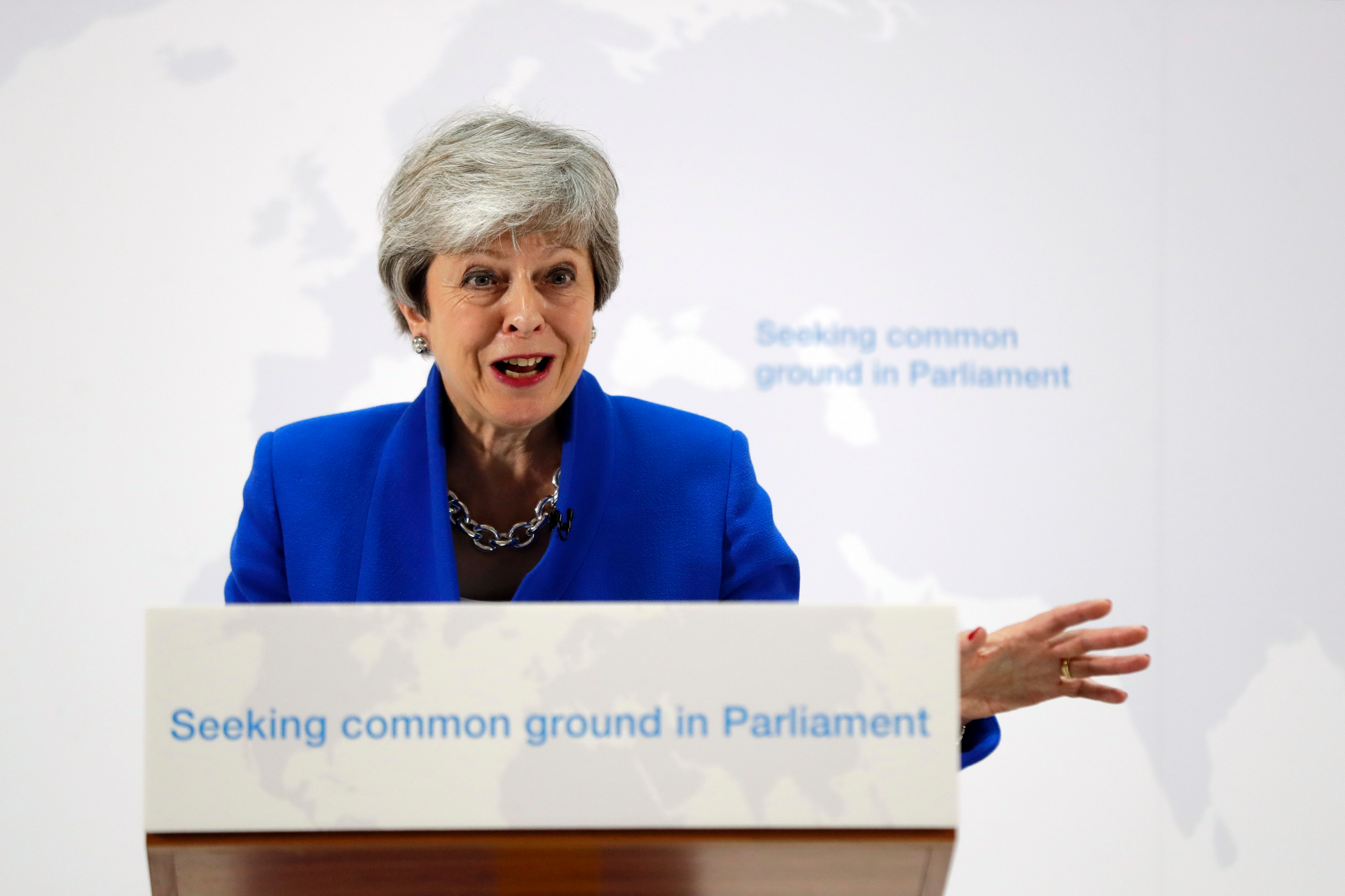 UK's May under fire after lawmakers reject Brexit offer