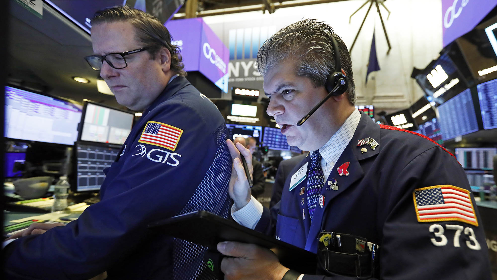 Stocks slide as markets look to extend record run
