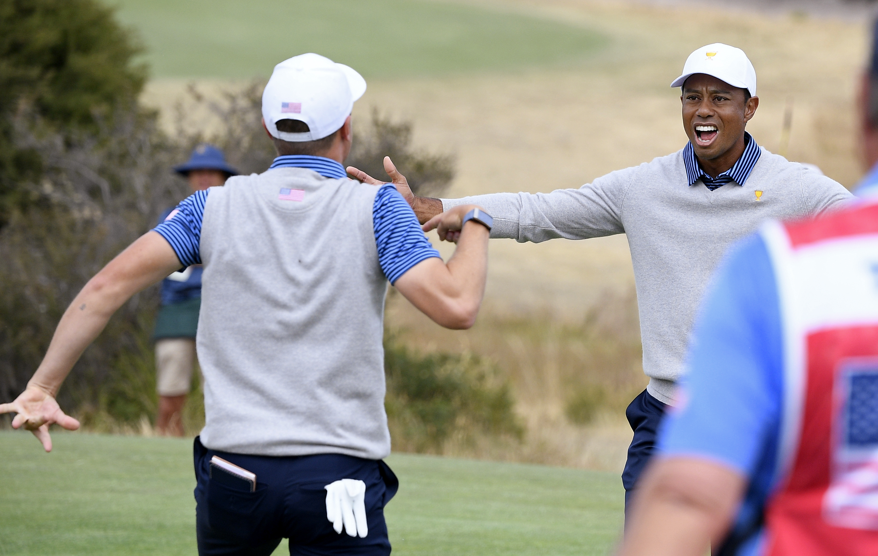 Tiger Woods' American team rallies at Presidents Cup, still trails internationals