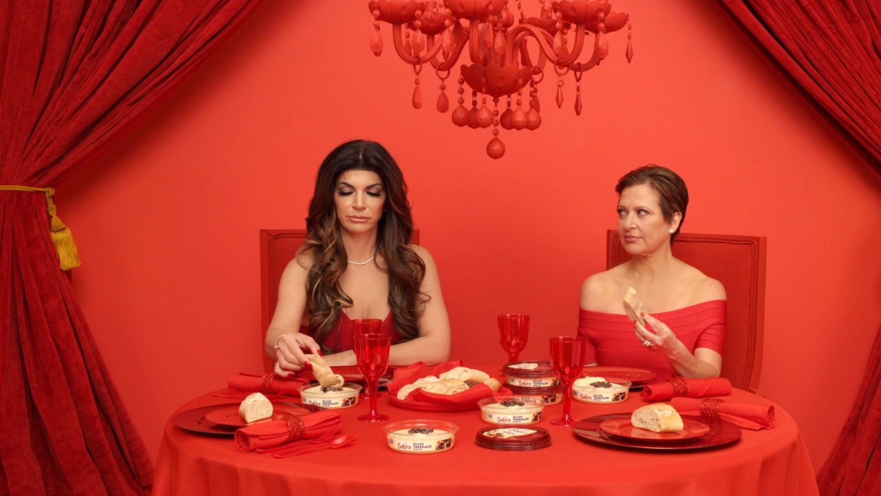 Super Bowl ad reunites 'Housewives' at dinner table for Sabra spot